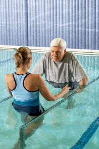 patient and therapist in aquatic physical therapy session