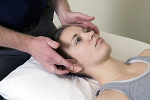 patient receiving TMJ therapy